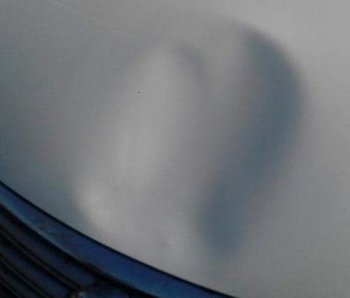 日产汽车引擎盖凹坑修复